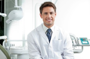 Happy Male Dentist In Clinic